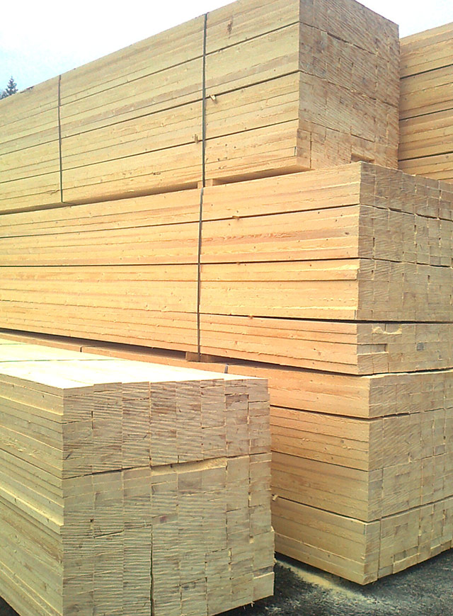 dried and sorted sawn timber bundles waiting for wrapping